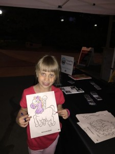 Our friend Sienna coloring and enjoying her night at the zoo.